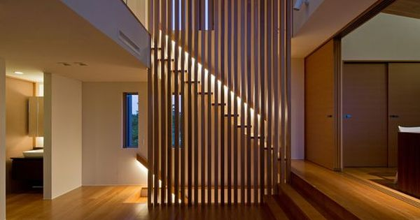 Down Lights From Railing Showcase Stairs Behind Slatted