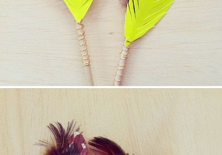 Painted feather arrows by Britt Bass. These are beautiful.