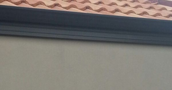 Terracotta Roof Tiles And Grey Solver Beaver Walls