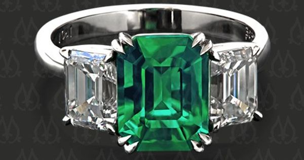 Three-stone ring with an emerald and two emerald cut diamonds by Leon
