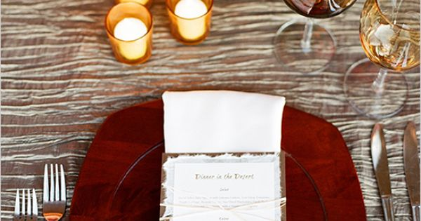 love this holiday tablescape. the tablecloth almost looks like woodgrain. rustic class.