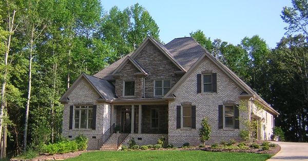 Mixing Stone And Brick Gives The Exterior Of This Newly