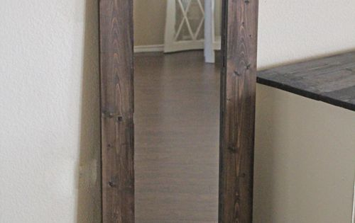 DIY mirror frame using a 5-dollar WalMart mirror. Project cost: