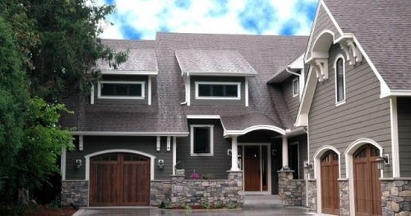 This high-contrast exterior features charcoal gray outlined with bright white trim. The