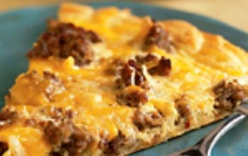 Breakfast Pizza- eggs, cheese, hashbrowns, sausage, on crescent roll dough... I don't