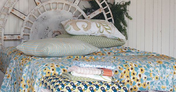 Spring-like bedroom scheme by Anthropologie. Love that clock face headboard!