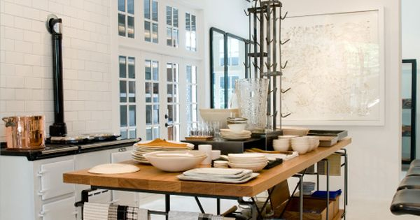 white kitchen with industrial accents. metal+wood kitchen island.