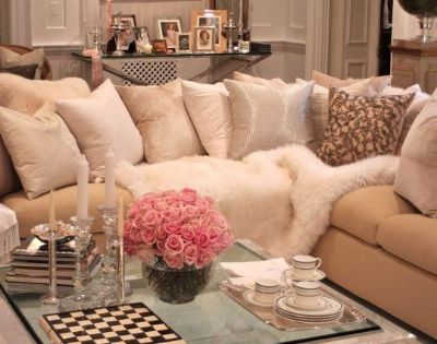 Old Hollywood Glamour - Lucite Coffee Table, Neutrals, and lots of pillows.