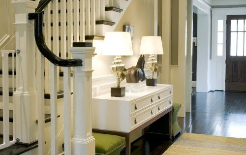 entryway. stairs & console table with pop of color seating.