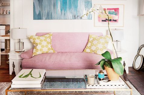 living room with pink sofa, glass coffee table via bryn alexandra