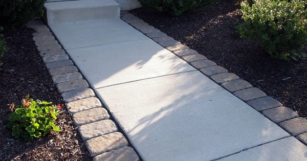 Pavers lining the sidewalk. Idea for front walkway