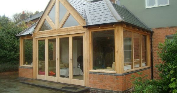 Oak and brick extensions google search sunroom for Timber frame sunroom addition