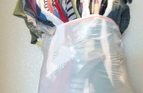 Put hanging clothes into garbage bags while still on the hanger. Thank