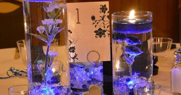 Each vase comes with a blue submersible LED, blue and clear glass