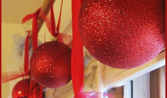 Styrofoam balls sprayed with glue then rolled in glitter. Much cheaper than