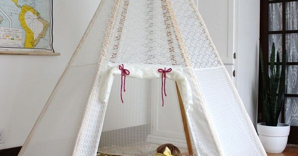 DIY Teepee (A Beautiful Mess). Like the clean lines of this one.