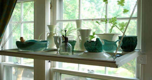 repurpose cupboard door for window display w/plants
