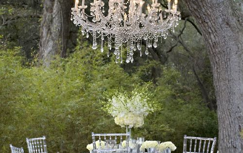 Love the chandelier hanging from the tree. Adorable tea setting.