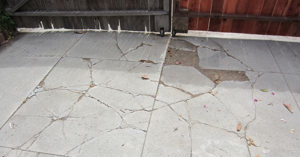 Next Problem Is The Driveway Cement Is Cracking Badly From