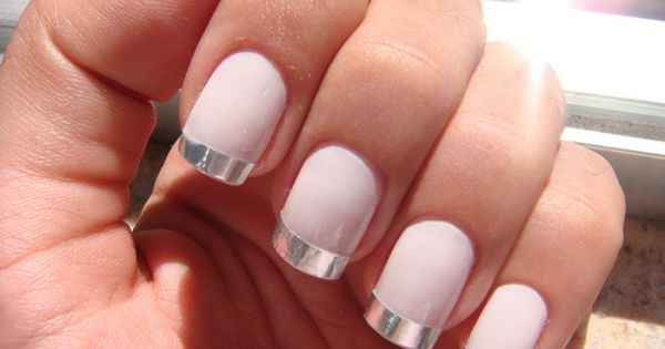 Very light pink nails with silver chrome French tips nail art
