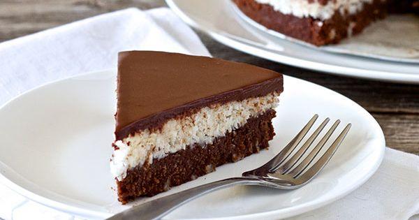 This paleo coconut chocolate cake recipe has three layers, super moist cake,