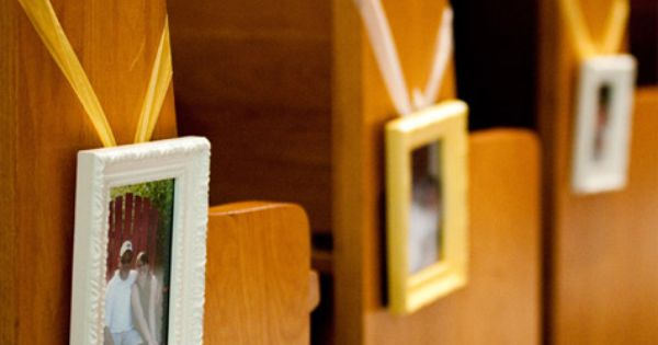 Picture frames as pew decoration.