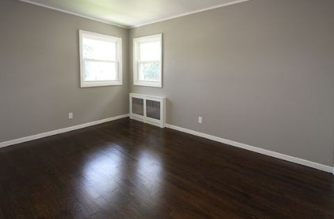 gray walls and dark wood floor grey walls white molding