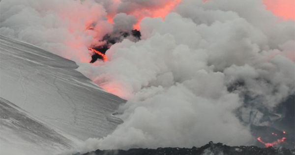 flowing lava vaporizing snow - Fimmvorduhals, Iceland. I really love these colors!