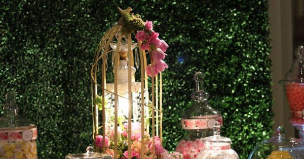 Garden theme candy buffet, boxwood backdrop, butterflies. Floral by Stephanie Do @