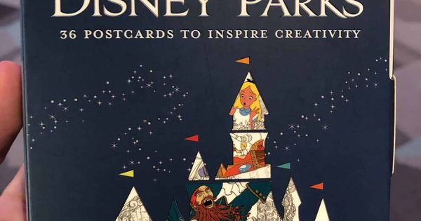 Photos Poster Art Of The Disney Parks And Maps Of The Disney Parks Coloring Books Arrive At Epcot Wdw News Today Poster Art Disney Parks Coloring Books