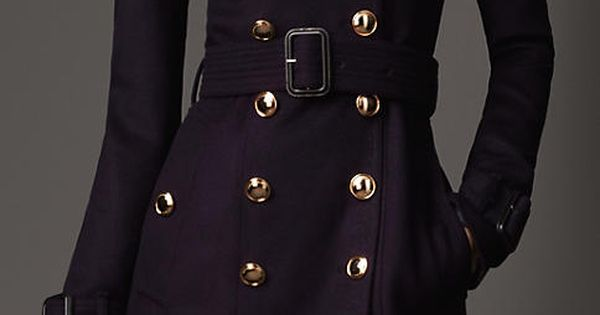 Burberry long frill detail, Trench Coat. A Burberry trench coat is high