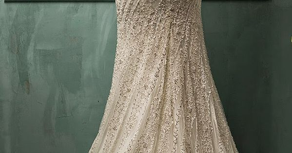Flared gored wedding gown skirt. Embellished wedding dress love by Amelia Sposa | heartoverheels.com