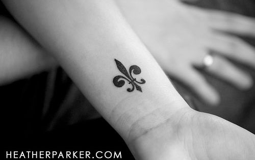 Fleur de lis tattoo. Not that I want a tattoo, but if