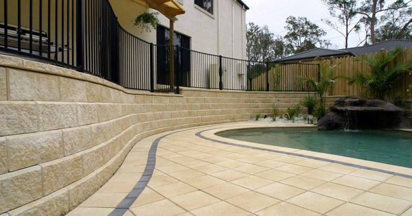 Match your paver and retaining wall colour for a cohesive for Besser block pool