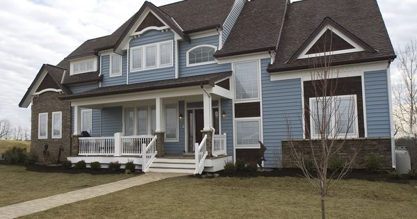 Blue Siding With The Dark Stone Is A Winning Combination