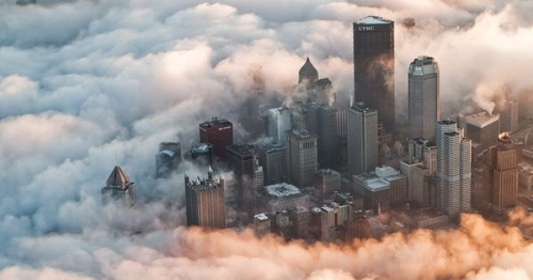 Love this picture!! Buildings are surrounded by fog. It almost looks like