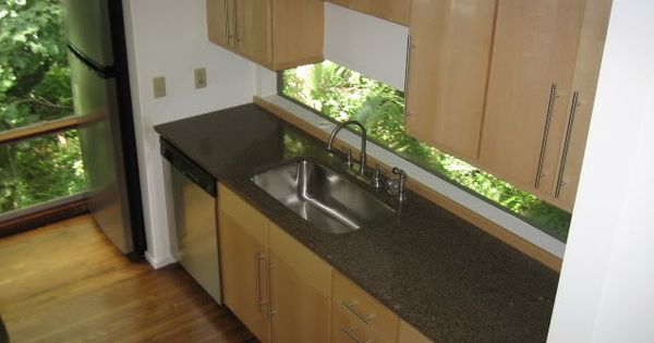 Birch cabinets with black countertops kitchen for small spaces