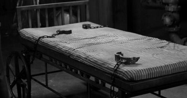 Old Bed With Restraint In Abandoned Asylum Let The Crazy