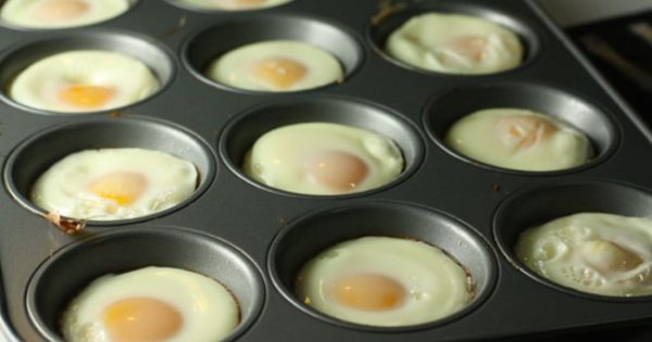 Cook eggs in a muffin pan for breakfast egg sandwiches. Make egg