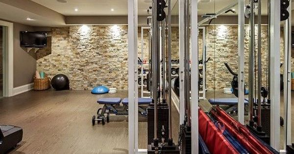 Killer accent wall in this home gym garage