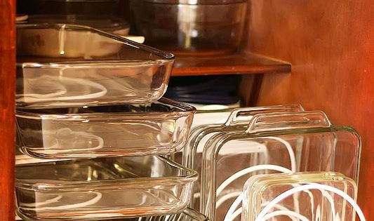 "Great organizing idea for baking dishes. ""Great space savers without stacking. Can"