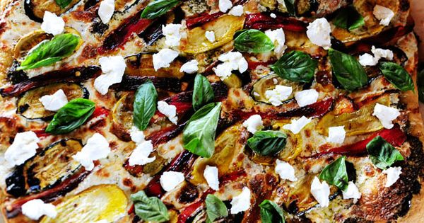 Grilled vegetable pizza with homemade pesto, fresh mozzarella, and goat cheese for