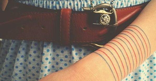 wrist tattoo. cute belt, dress necklace. all winning.