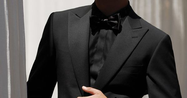 This is one clean tuxedo although it opts for high peak for Tuxedo shirt covered placket