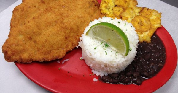 Bistec empanizado, served with rice & beans and tostones ...