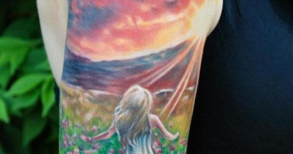 Stunning girl and sunset tattoo
