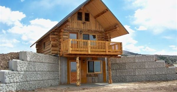 Tiny house with basement in hillside the recently for Log cabin with walkout basement