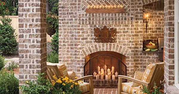 Ooo-la-la! Back porch outdoor fireplace... great idea for whenever I get rich;)