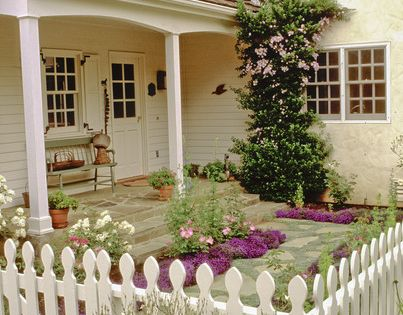 White English Cottage Decor | Cottage style courtyard garden with white picket