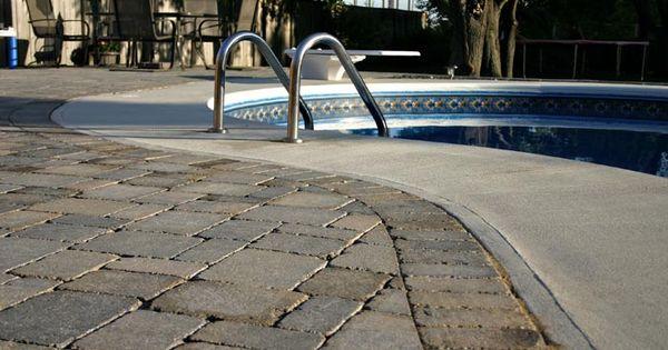 Sierra Grey Roman Pavers Edging Around Concrete Pool Edge